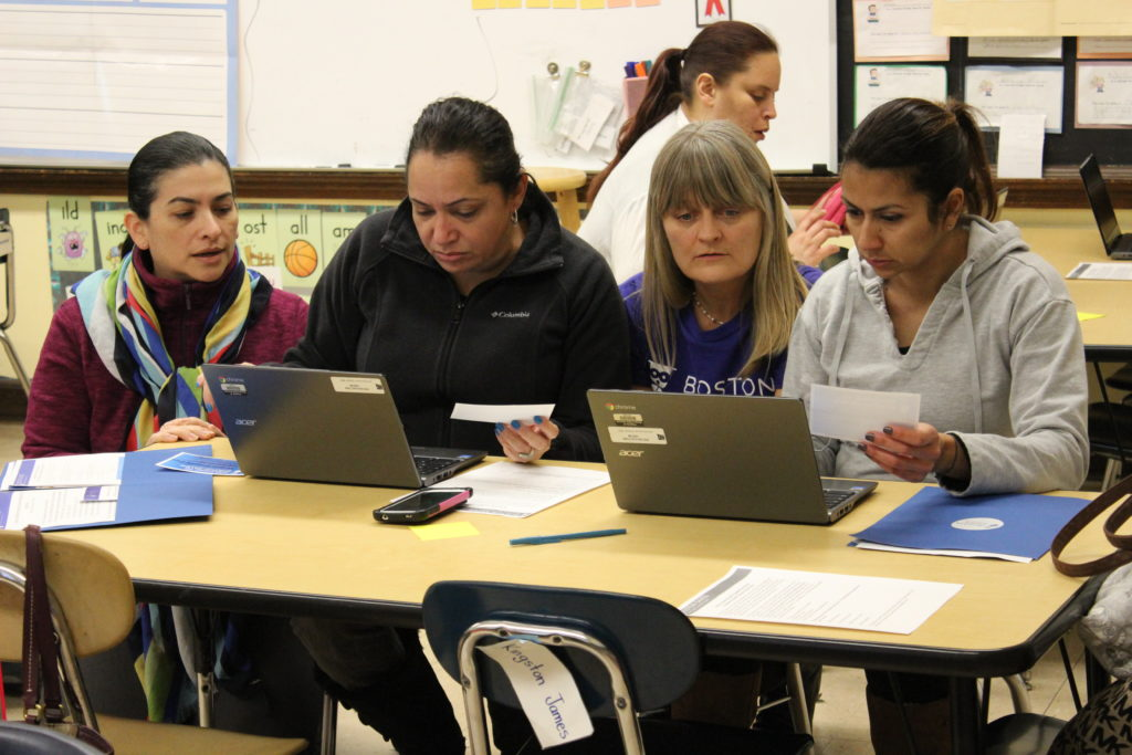 four women at laptops
