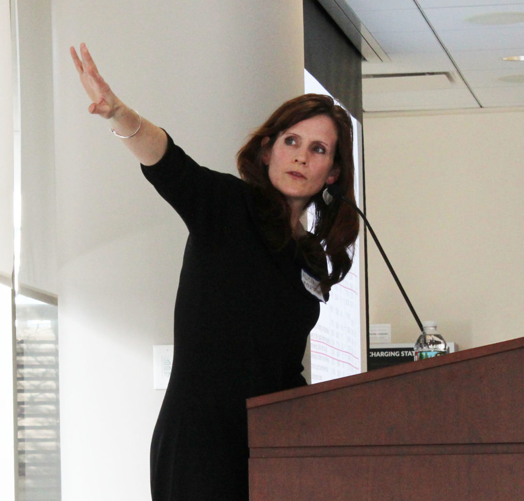 woman at podium pointing