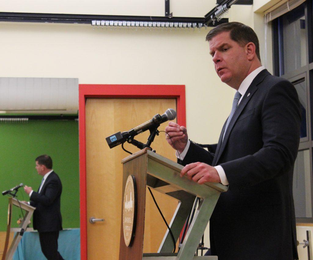 Mayor speaking at the podium